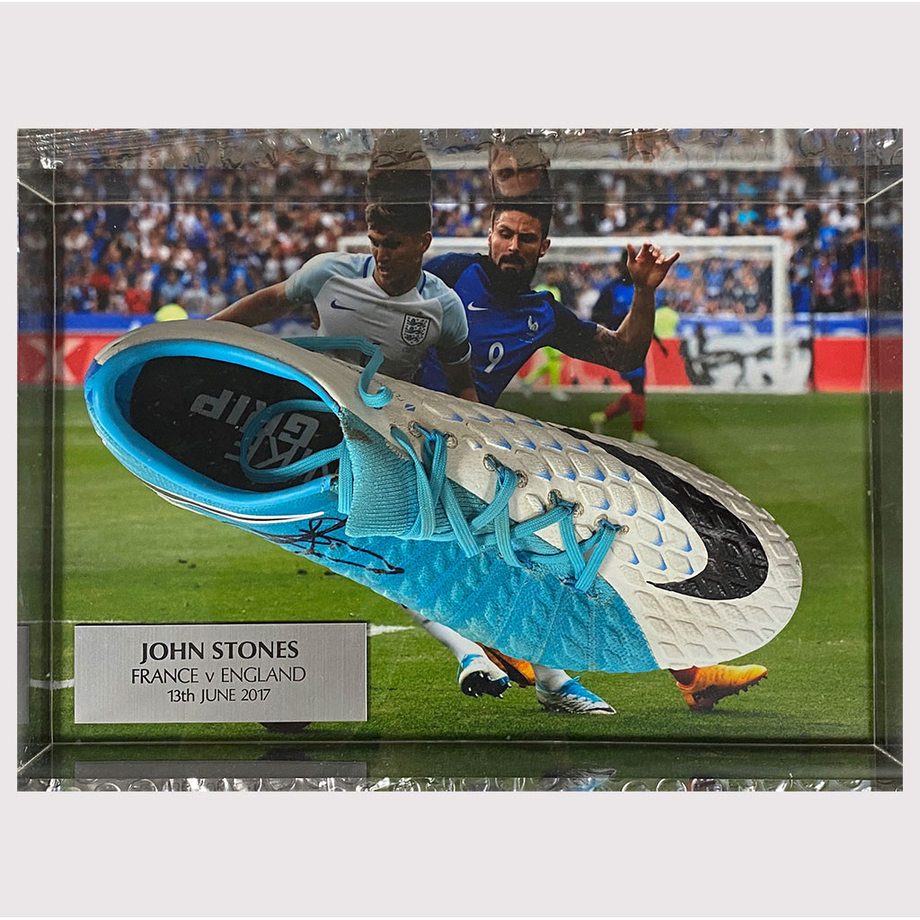 John Stones Signed Worn Boots in Glass Case